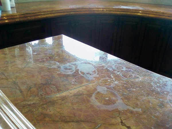 Getting hard water stains off your natural stone is important for your Miramar flooring.