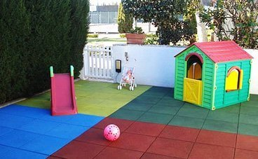 Outdoor soft flooring with rubber.